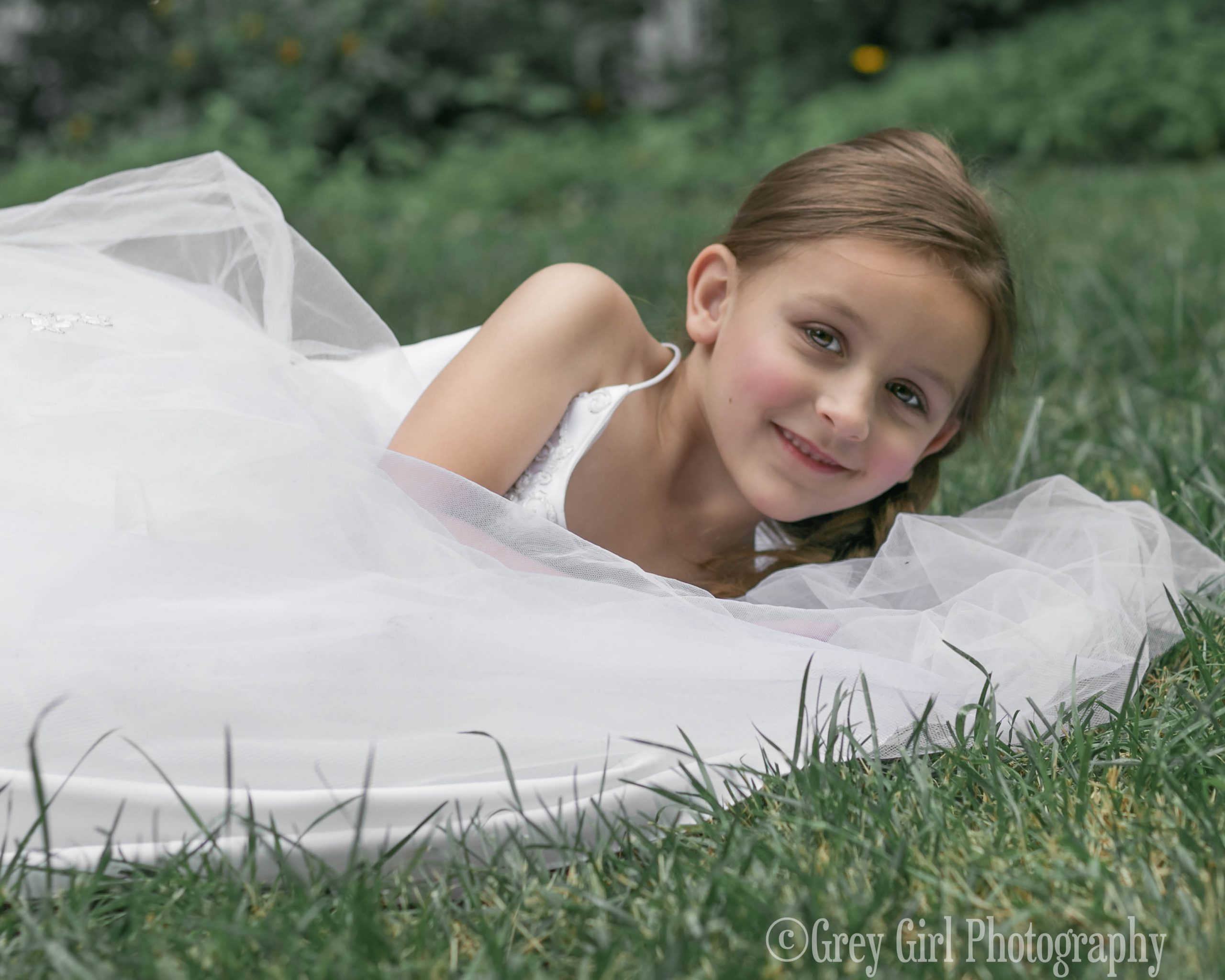 Fine Art Portrait of a girl in grass and gown in Reading, PA
